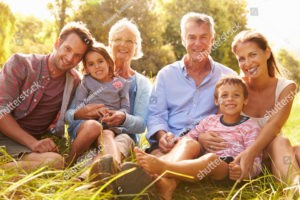 happy multi-generational family in park