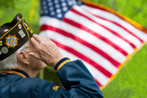 Veteran saluting flag - Herb Chavers Law Firm